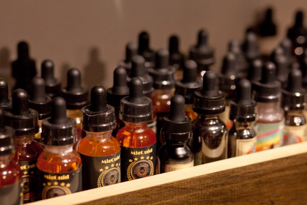 "Vape shops like M Street Vape offer a variety of nicotine-infused ""e-juices."""