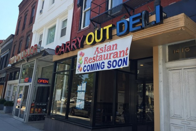 "A ""coming soon"" banner hangs over the front door of the restaurant, set to open next Friday"