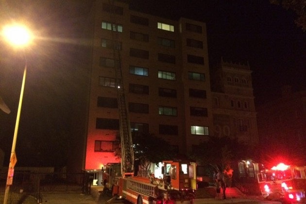Firefighters extended a ladder to the top of the building but found no fire, just burned food