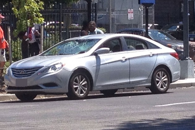 A car on the scene with a smashed windshield