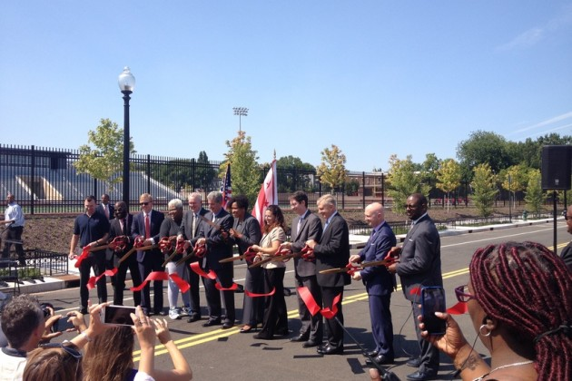 Mayor Bowser cuts the ribbon to open the green street stretch of O Street NW.