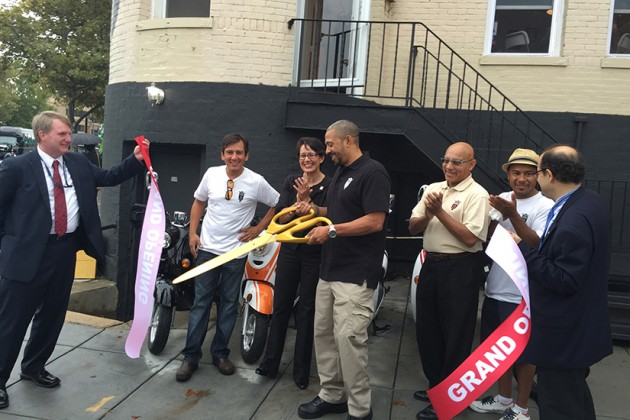 U Scoot owner Andre Esser did the honors at his business