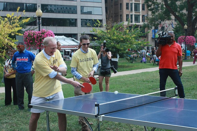 Councilmembers Jack Evans and Charles Allen compete in the doubles tournament.