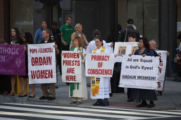 Women's Ordination Conference members arrived and held signs