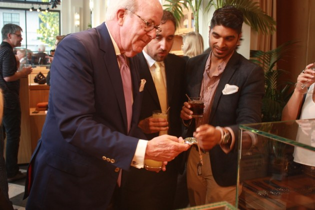Guests examine a hand-made watch