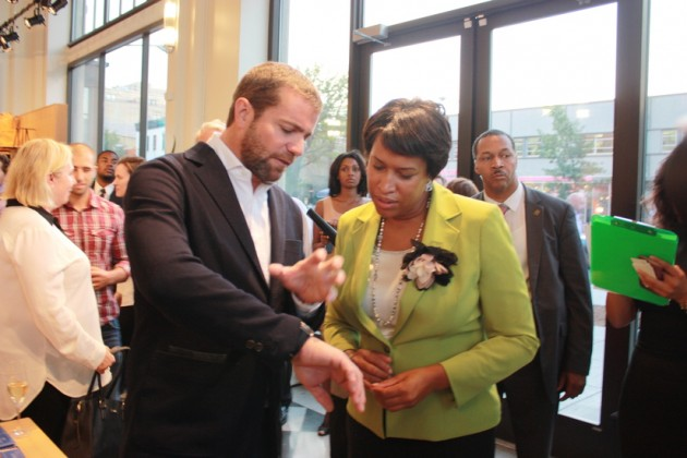 Shinola President Jacques Panis shows off his watch to Mayor Muriel Bowser