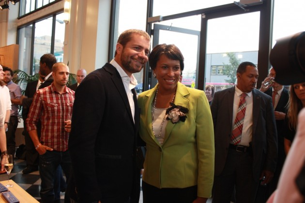 Bowser and Panis pose for a photo at the Shinola Grand Opening