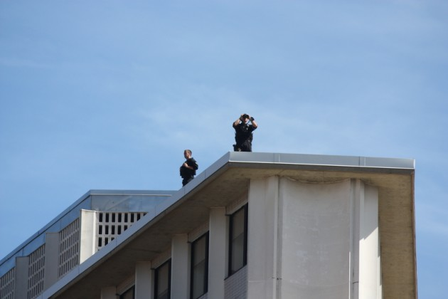 Spotters donned binoculars on a roof near the cathedral