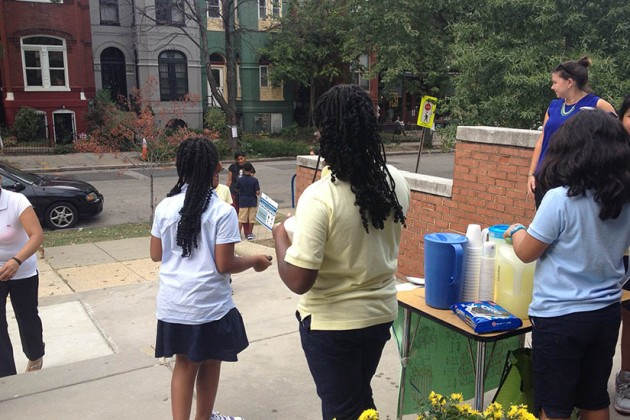 Fourth graders advertise their lemonade stand to passers-by at Garrison Elementary