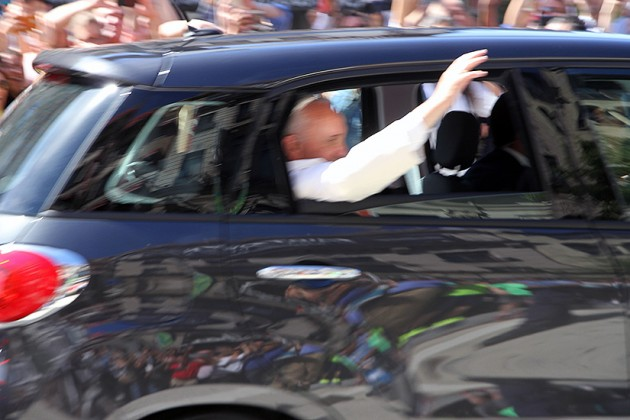 Pope Francis waved to the crowd as he left the cathedral