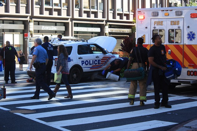 Witnesses say a police officer ran into a pedestrian on the crosswalk around 1:44 p.m. today
