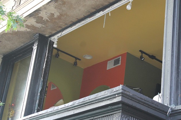Firefighters broke the salon's windows to battle the blaze