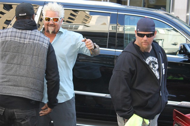 Fieri emerged from the car energetic (as always)