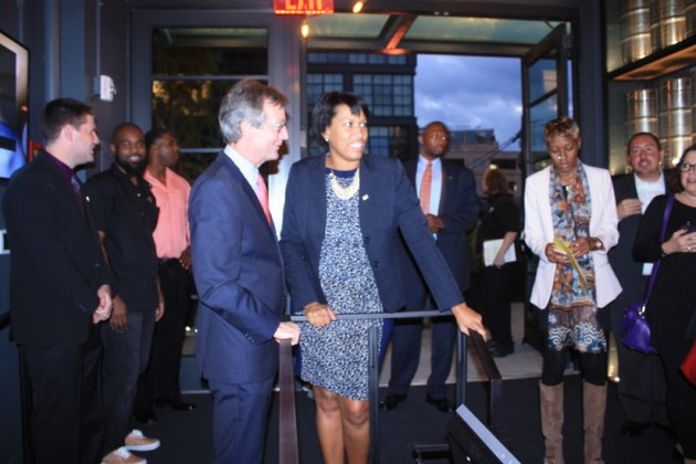 Landmark CEO Ted Mundorff welcomes Mayor Muriel Bowser to the theater
