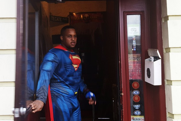 Doorman Jelani Wills beckons patrons inside