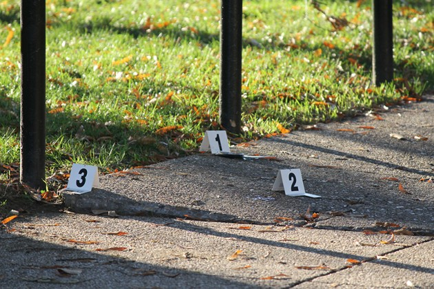 Evidence markers and an object that appears to be a knife
