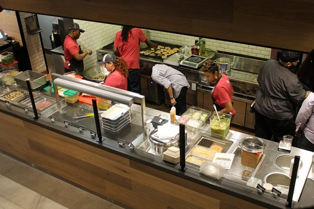 Workers were busy prepping veggies and protein ahead of the eatery's opening