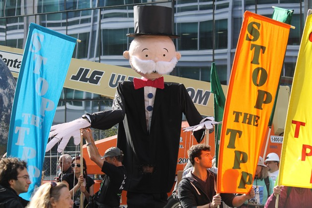 A giant Monopoly Man operated by several puppeteers
