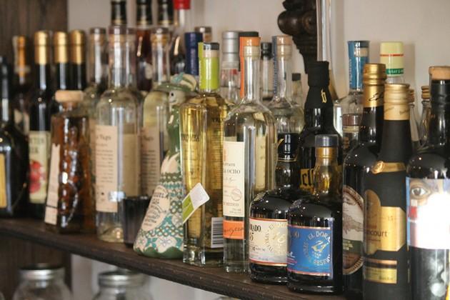 A multitude of bottles pack the bar's shelves
