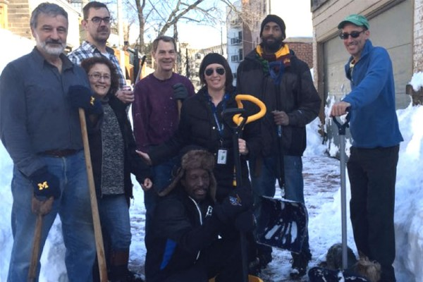 Councilmember Brianne Nadeau of Ward 1 (center) helps Mount Pleasant residents shovel (Photo via Twitter/Brianne K. Nadeau)