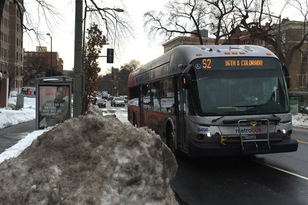 S2 bus travels past snow on 16th Street NW