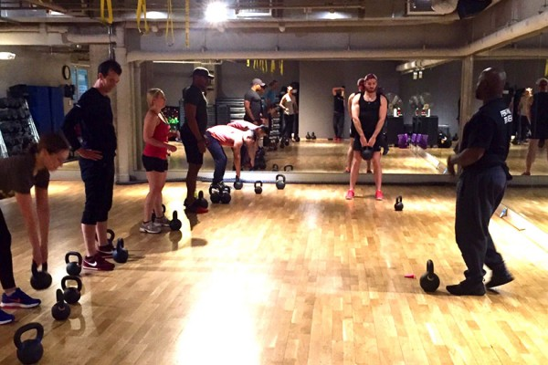 VIDA trainer Will Thompson leading a Kettlebells demo for our Metropole team