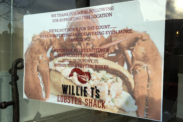 A sign posted on the front door of the business says Willie T's is moving