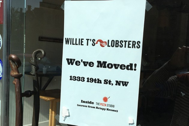 """We've moved!"" reads a sign at the former home of Willie T's Lobster Shack"