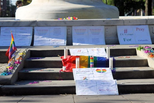 Mourners left candles and tributes during a separate vigil last night