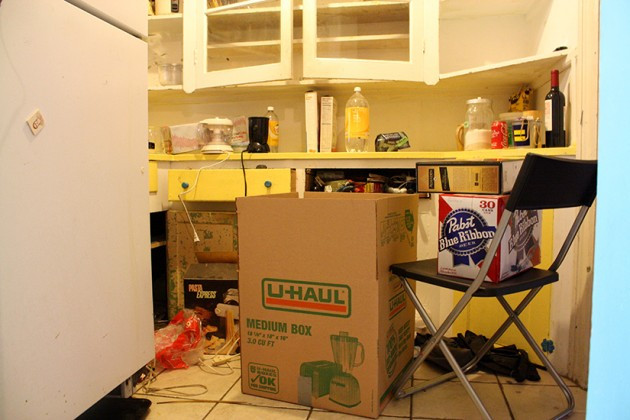 Boxes and items scattered across the kitchen