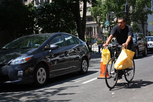 Cyclists are forced to merge with traffic along the 1500 block of L Street NW