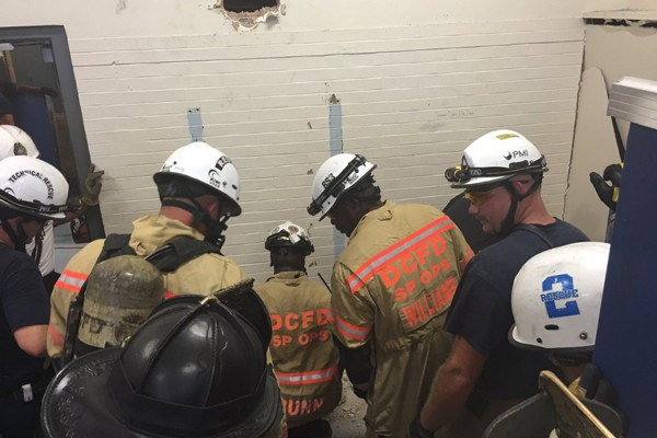 Firefighters rescue woman near U Street Aug 2016, photo via Twitter : D.C. Fire and EMS