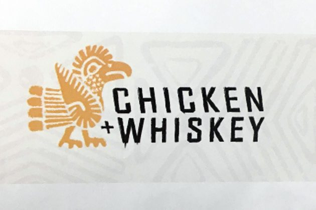 Chicken and Whiskey's logo on a handout distributed at the meeting