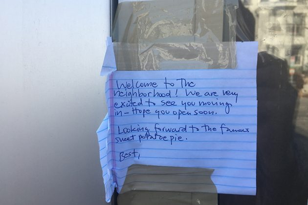 Note from neighbors left on the front door